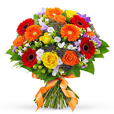 This hand-tied bouquet of multi-colored flowers arrives tied and wrapped, ready for the recipients favorite vase.