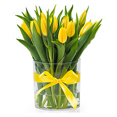 Brighten any day with this nice flower arrangement of yellow tulips with vase.