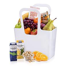 """Des fruits classiques, mûrs et sains sont soigneusement emballés à la main dans un Cabas """"TascheLino"""" par Koziol."""