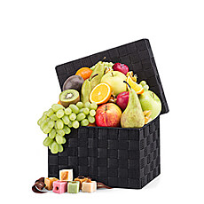 A unique Neuhaus Marzipan cello box is paired with an abundance of handpicked fresh fruit in our delicious new gift hamper.