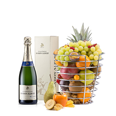 Surprise your dearest friends by giving them the Design Basket from Korb filled with a Fresh and Exotic Fruit Selection and Baron Albert Champagne.