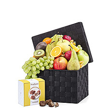 A scrumptious selection of the best seasonal classic fruit is carefully hand packed into a handsome woven gift hamper and paired with delicious Neuhaus Belgian chocolate Rose Des Sables.