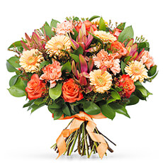Brighten her day with this this vibrant bouquet in stunning fall colors. Beautiful flowers in gorgeous shades of orange are set off by fresh green accents and hints of bold pink.
