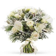 Cet élégant bouquet nouvel an dans des tons blancs et argentés apporte une touche douillette à chaque pièce de la maison.