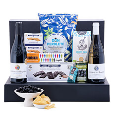 A duo of French red and white wines is presented with a tempting selection of European gourmet snacks and Belgian chocolates in an elegant gift box. A sophisticated gourmet gift idea for any occasion.