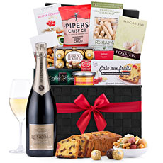 Surprise friends, family, and colleagues in Europe with this elegant gourmet gift basket with Champagne today!