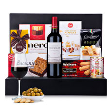 "Our elegant new gourmet gift basket offers a rich array of fine European foods paired with a lovely French red wine. A sophisticated gourmet gift idea for corporate gifting, Christmas, birthdays, and to delight the ""foodies"" in your life."