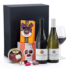 A bottle of luscious Château des Roques Vaqueyras French red wine and a bottle of Château Des Roques Vacqueyras white wine are paired with Belgian chocolates by Neuhaus and Corné Port-Royal in this elegant business gift set.