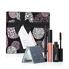 The special women in your life are sure to delight in this feminine gift set featuring luxurious makeup .
