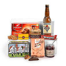 The best tastes of Belgium await discovery in a large woven gift hamper, including De Poe beer, gourmet savory spreads, and Belgian chocolate by Neuhaus, Côte d'Or, and Corné Port-Royal.