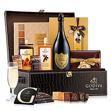 This sophisticated Dom Perignon and Godiva chocolate gift set is the ultimate in style and taste. Dom Perignon Vintage 2006 Champagne and a wealth of Godiva Belgian chocolate are presented in a magnificent leather gift hamper.
