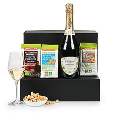 Make any day a celebration with a bottle of Raza Fair Trade Torrontés Brut sparkling wine from Argentina. Paired with Ethiquable dark chocolate truffles and crunchy Fair Trade cashews, this Trias gift set is elegant, stylish, and ethical.