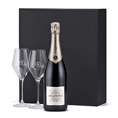 A sparkling bottle of Champagne Lenoble Blanc de Blancs is presented in a luxury black gift box with a pair of signature glasses. Lenoble Champagne Grand Cru Blanc de Blancs is the 2010 winner of the prestigous Concours De Bruxelles.
