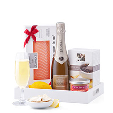 We present artisan salmon, Champagne Lenoble, pastinade from Provence, and premium crackers in a chic serving tray for a sophisticated appetizer to share and enjoy.