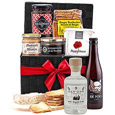 Ce panier tressé noir comprend un délicieux assortiment de produits régionaux 100% Flandre occidentale pour profiter d'un agréable apéritif.