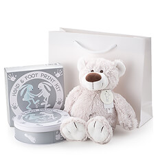 Welcome a new baby with this special newborn gift featuring a lovable plush bear for baby and a hand & footprint kit for parents to capture precious memories. An ideal newborn gift for a boy or a girl.