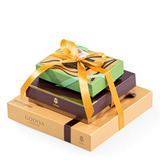 Indulge your friends and family with this impressive Godiva gift tower. They will delight in the wonderful combination of favorite Godiva filled chocolates, gourmet chocolate truffles, and the innovative new Godiva Icônes d'Or collection.