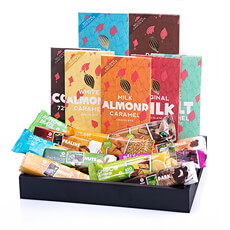 Treat your favorite chocolate lover to this fantastic collection of 18 Oxfam Fair Trade chocolate bars and tablets! This scrumptious assortment of milk and dark chocolates is bursting with delicious additions, including nuts, fruit, coconut, caramel, and so much more.
