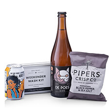 Get ready for the weekend with our new travel kit containing a Men's Society Weekender Wash Kit, De Poes beer, Piper's Crisp chips, and a refreshing can of organic Fair Trade ice tea.