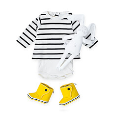 This soft, stylish Petit Bateau baby gift features a classic sailor striped bodysuit, adorable yellow boots, and the cutest rabbit lovey.