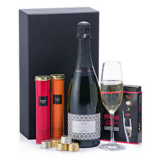 Celebrate festive occasions with this elegant gift of sparkling Cava, unique botanicals, and Belgian chocolates. Beautifully presented in a chic black gift box, it's an ideal Valentine's, birthday, or anniversary gift.