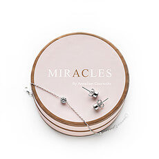 Bring a touch of glamor to her life with this amazing Miracles earrings and bracelet jewelry set.
