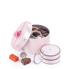This beautiful feminine gift is a wonderful way to show the special ladies in your life how much you care for them. The luxury Neuhaus Belgian chocolate and a sparkling bracelet by Miracles will make her feel pampered and pretty.