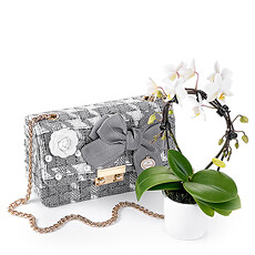 A lovely gift for the special women in your life: a beautiful bag with a miniature white orchid.