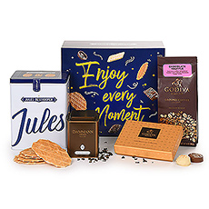 A cheerful Jules Destrooper gift box is filled with favorite treats for a relaxing snack, teatime, or dessert this holiday season. Delicious coffee, tea, biscuits, and Godiva chocolates await the lucky recipient.