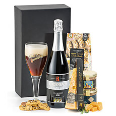 A bottle of Rodenbach Grand Cru Belgian beer is presented with Dutch cheese, a duo of artisan Belgian beer patés, and tasty biscuits.