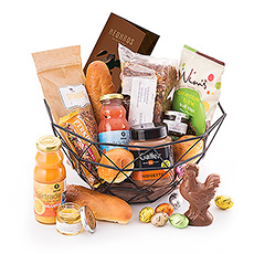 This decorative breakfast basket is packed with all kinds of delicious treats for Easter morning.