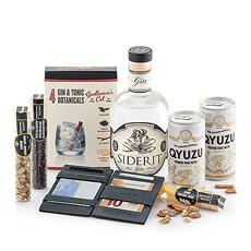 Ce set cadeau qui comprend le portefeuille Magique luxueux de la marque Garzini, une bouteille de Siderit Gin dEspagne, Qyuzu Premium Tonic et les Botanicals de Food Travellers, plaira à chaque homme.