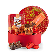 A unique round red gift box is decorated with shimmering golden glitter. Inside the special box is a delicious assortment of Belgian chocolate treats.