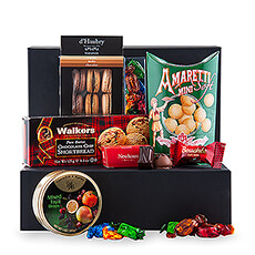 The Sweet Tooth Large offers a delicious collection of sweets, presented in a luxurious black gift box to surprise your favorite sweet tooth.