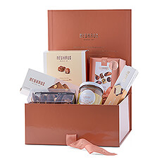 Discover the world of chocolate with this unique, luxurious gift box filled with a selection of Neuhaus' best chocolate delicacies. This is a wonderful gift to introduce friends or family to the Neuhaus range.