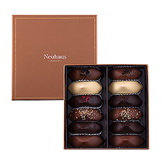 This prestigious gift box offers a delicious assortment of 12 hand filled Irrésistibles with fresh cream or ganache.