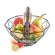 Profitez de ce cadeau qui vous ramène à la Belle Époque grâce à cette corbeille de fruits de luxe contenant de la liqueur Saint-Germain aux fleurs de sureau.