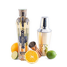 Shake it up with this luxurious cocktail set with St. Germain elderflower liqueur, a jigger, a cocktail shaker and a selection of citrus fruits.