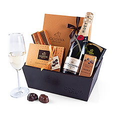 This large leather Christmas hamper full of Godiva chocolate, with sparkling Moët & Chandon champagne is a great luxury gift!