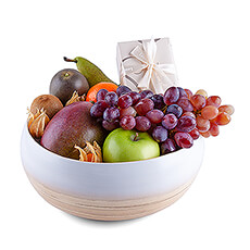 Treat someone special to this stylish new eco-friendly fruit and chocolate gift. A scrumptious selection of classic and exotic fresh fruit is presented in a beautiful LO Tableware bamboo bowl.