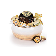 The beautiful, eco-friendly bamboo bowl from LO Tableware is filled with an assortment of coffee sweets, Ferrero Rochers and white Bouchées from Côte dOr.
