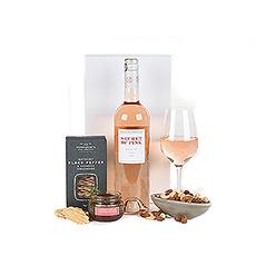 Vin rosé unique et fruité, complété par de délicieuses collations pour l'apéritif idéal.