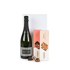 Un set cadeau prestigieux avec une bouteille de cava, les manons populaires de Neuhaus et des biscuits d'amandes de Neuhaus pour faire expédier à pour chaque occasion.