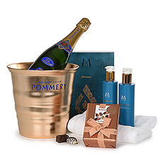 This gift offers a luxurious bottle of Pommery Brut Champagne, combined with a wellness gift box by Mylène and a ballotin with Neuhaus chocolates.