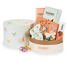 Send Easter joy with a lovely spring Easter ballotoeuf gift box filled with a delicious collection of Neuhaus Belgian chocolate.