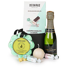 Everyone needs to take some time off to relax; make down time the best time with sparkling Cava, new Neuhaus chocolate Amusettes, a coconut verbena sponge, and a lovely scented candle.