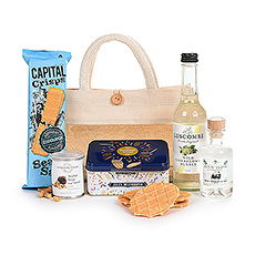 Take your Apero anywhere with this handy ecological tote bag fill with delicious Jules Destrooper butter crisp cookies in a festive tin, gourmet truffle peanuts, and sea salt Capital Crisps, Belgian gin, and an elderflower soft drink.