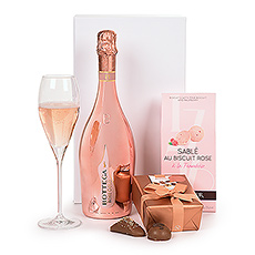 Surprise her with this uplifting pink gift featuring Bottega Rose Gold Pinot Noir Sparkling Rosé, Fossier Sable Rose Biscuits Framboise, and luxury Neuhaus Belgian chocolates.
