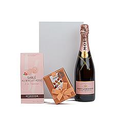 """Faites-lui une surprise en lui offrant ce cadeau rose exaltant composé de """"Bottega Rose Gold Pinot Noir Brut Rosé"""", de biscuits Framboise de Fossier Sable Rose et de luxueux chocolats belges Neuhaus."""