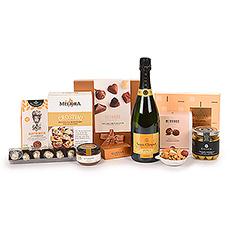 Nous vous présentons l'un de nos cadeaux les plus exquis :l'Ultimate Gourmet avec le prestigieux champagne Veuve Clicquot Vintage 2012. Le superbe champagne est accompagné d'une sélection soigneusement sélectionnée des meilleures spécialités gastronomiques européennes et de chocolats belges de luxe